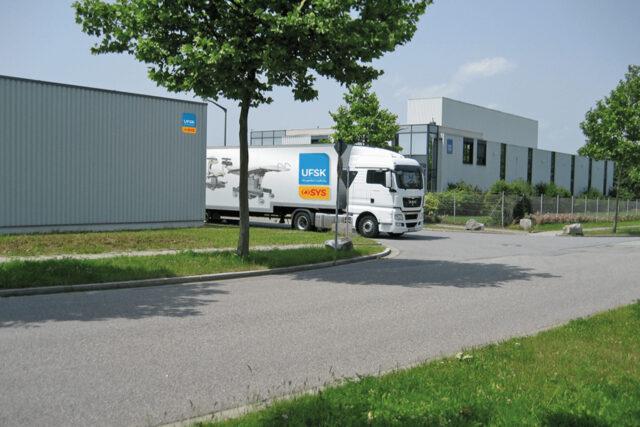 Firmengebäude und Transporter UFSK-OSYS